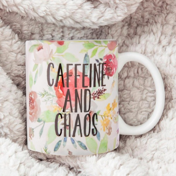 """Ceramic mug that has the phrase """"Caffeine and Chaos"""" printed on both sides with floral accents.  - Holds up to 8 fl oz"""