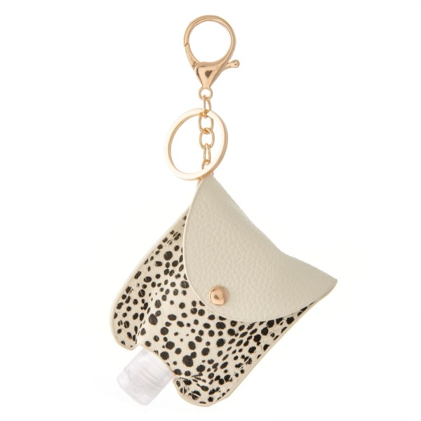 "Keep Your Self Protected While You're Out and About with This Cute Faux Leather Cheetah Print Hand Sanitizer Holder.   - Clip to your purse, bag, or diaper bag - Key ring to hold your keys - Fits up to 1fl.oz Sanitizer Bottle - Approximately 3"" T x 2.5"" W  ***Hand Sanitizer NOT INCLUDED. (Comes with empty Bottle)"