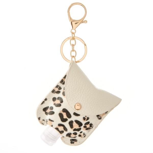 "Keep Your Self Protected While You're Out and About with This Cute Faux Leather Leopard Print Hand Sanitizer Holder.   - Clip to your purse, bag, or diaper bag - Key ring to hold your keys - Fits up to 1fl.oz Sanitizer Bottle - Approximately 3"" T x 2.5"" W  ***Hand Sanitizer NOT INCLUDED. (Comes with empty Bottle)"