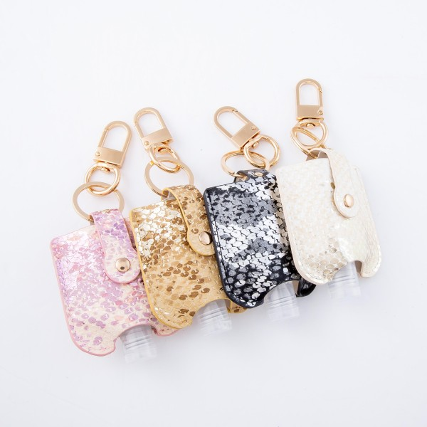 """Keep Your Self Protected While You're Out and About with This Cute Faux Leather Metallic Snakeskin Hand Sanitizer Holder.   - Clip to your purse, bag, or diaper bag - Key ring to hold your keys - Fits up to 1fl.oz Sanitizer Bottle - Approximately 3"""" T x 2.5"""" W  ***Hand Sanitizer NOT INCLUDED. (Comes with empty Bottle)"""