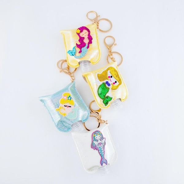 """Keep Your Self Protected While You're Out and About with This Cute White Metallic Glitter Mermaid Hand Sanitizer Holder.  - Clip to your purse, bag, or diaper bag - Key ring to hold your keys - Fits up to 1fl.oz Sanitizer Bottle - Approximately 3"""" T x 2.5"""" W  ***Hand Sanitizer NOT INCLUDED. (Comes with empty Bottle)"""