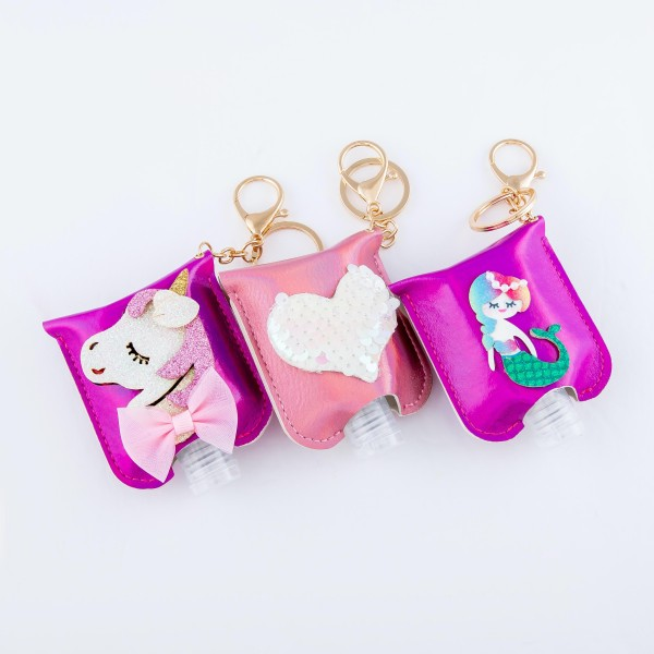 """Keep Your Self Protected While You're Out and About with This Cute Pink Metallic Sequin Heart Hand Sanitizer Holder.  - Clip to your purse, bag, or diaper bag - Key ring to hold your keys - Fits up to 1fl.oz Sanitizer Bottle - Approximately 3"""" T x 2.5"""" W  ***Hand Sanitizer NOT INCLUDED. (Comes with empty Bottle)"""