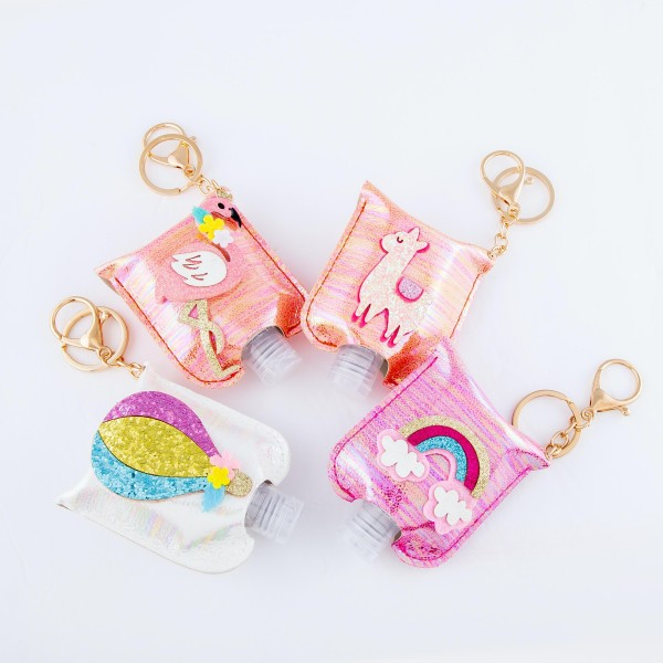 """Keep Your Self Protected While You're Out and About with This Cute White Metallic Glitter Hot Air Balloon Hand Sanitizer Holder.  - Clip to your purse, bag, or diaper bag - Key ring to hold your keys - Fits up to 1fl.oz Sanitizer Bottle - Approximately 3"""" T x 2.5"""" W  ***Hand Sanitizer NOT INCLUDED. (Comes with empty Bottle)"""