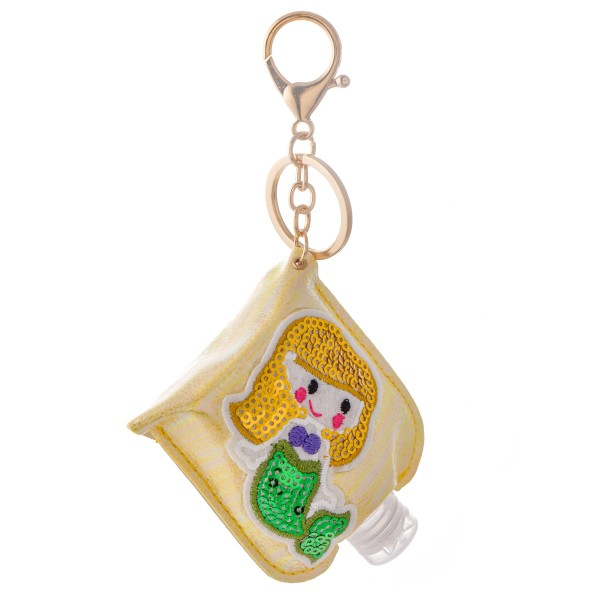 """Keep Your Self Protected While You're Out and About with This Cute Yellow Metallic Sequin Mermaid Hand Sanitizer Holder.  - Clip to your purse, bag, or diaper bag - Key ring to hold your keys - Fits up to 1fl.oz Sanitizer Bottle - Approximately 3"""" T x 2.5"""" W  ***Hand Sanitizer NOT INCLUDED. (Comes with empty Bottle)"""