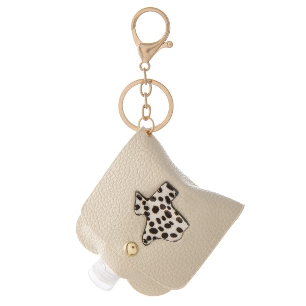 """Keep Your Self Protected While You're Out and About with This Genuine Leather Cow Hide Texas State Hand Sanitizer Holder.  - Clip to your purse, bag, or diaper bag - Key ring to hold your keys - Fits up to 1fl.oz Sanitizer Bottle - Approximately 3"""" T x 2.5"""" W  ***Hand Sanitizer NOT INCLUDED. (Comes with empty Bottle)"""