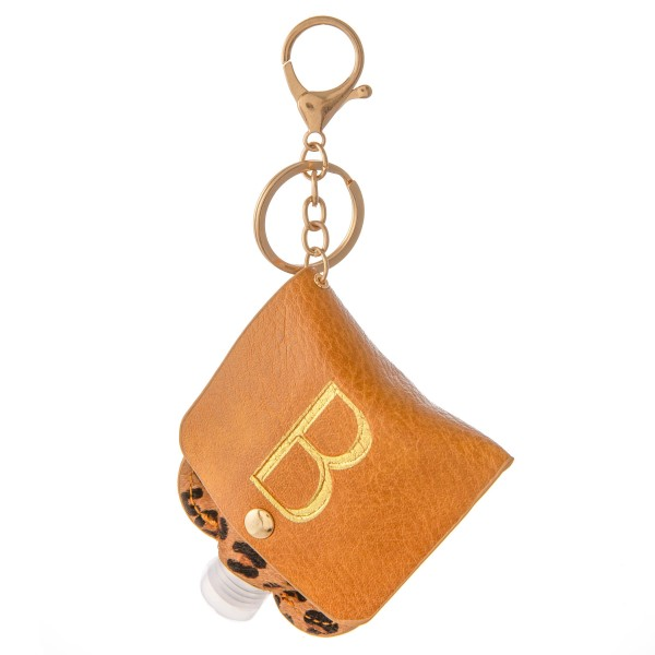 """Keep Your Self Protected While You're Out and About with This Genuine Leather Initial Leopard Print Hand Sanitizer Holder.  - Clip to your purse, bag, or diaper bag - Key ring to hold your keys - Fits up to 1fl.oz Sanitizer Bottle - Approximately 3"""" T x 2.5"""" W  ***Hand Sanitizer NOT INCLUDED. (Comes with empty Bottle)"""