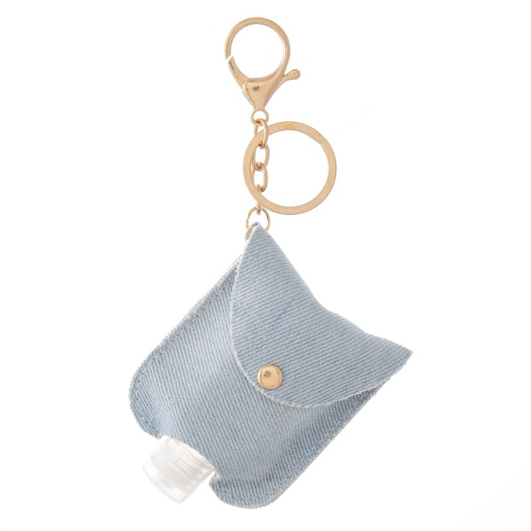 """Keep Your Self Protected While You're Out and About with This Cute Denim Style Tie-Dye Hand Sanitizer Holder.  - Clip to your purse, bag, or diaper bag - Key ring to hold your keys - Fits up to 1fl.oz Sanitizer Bottle - Approximately 3"""" T x 2.5"""" W"""