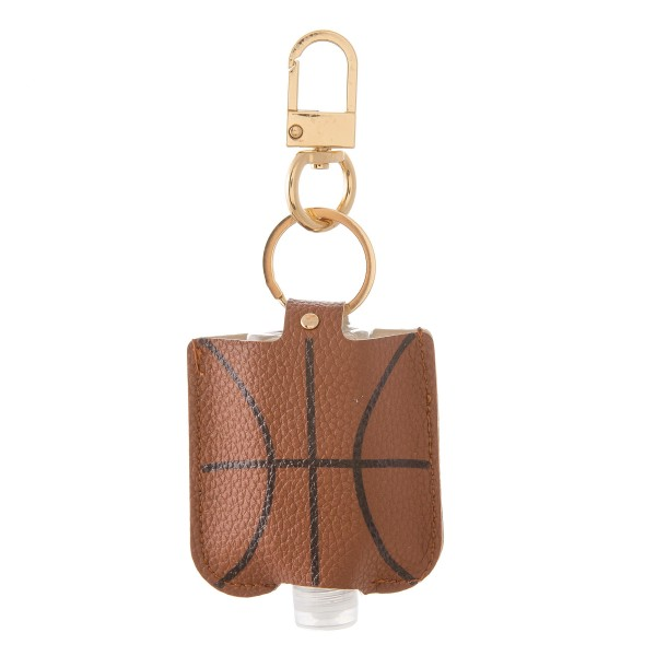 """Keep Your Self Protected While You're Out and About on Game Day with This Faux Leather Basketball Hand Sanitizer Holder.  - Clip to your purse, bag, or diaper bag - Key ring to hold your keys - Fits up to 1fl.oz Sanitizer Bottle - Approximately 3"""" T x 2.5"""" W  ***Hand Sanitizer NOT INCLUDED. (Comes with empty Bottle)"""