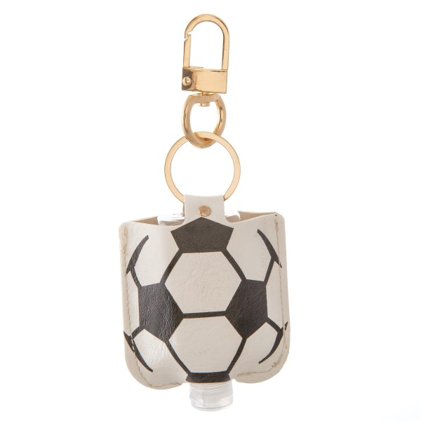 """Keep Your Self Protected While You're Out and About on Game Day with This Faux Leather Soccer Hand Sanitizer Holder.  - Clip to your purse, bag, or diaper bag - Key ring to hold your keys - Fits up to 1fl.oz Sanitizer Bottle - Approximately 3"""" T x 2.5"""" W  ***Hand Sanitizer NOT INCLUDED. (Comes with empty Bottle)"""