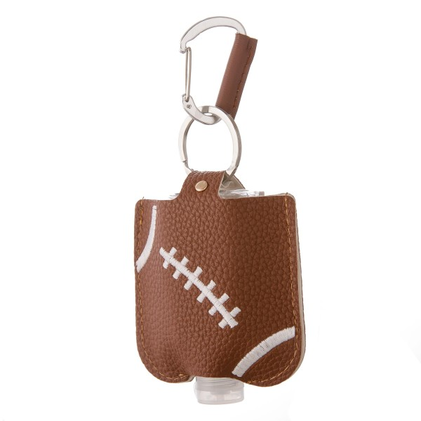 """Keep Your Self Protected While You're Out and About on Game Day with This Faux Leather Football Hand Sanitizer Holder.  - Clip to your purse, bag, or diaper bag - Key ring to hold your keys - Fits up to 1fl.oz Sanitizer Bottle - Approximately 3"""" T x 2.5"""" W  ***Hand Sanitizer NOT INCLUDED. (Comes with empty Bottle)"""