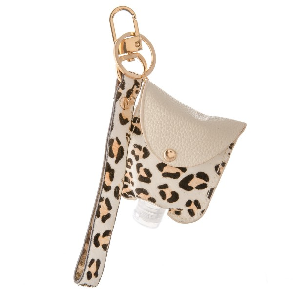 "Keep Your Self Protected While You're Out and About with This Faux Leather Leopard Print Hand Sanitizer Holder Wristlet.  - Clip to your purse, bag, or diaper bag - Key ring to hold your keys - Detachable Wristlet 7""  - Fits up to 1fl.oz Sanitizer Bottle - Approximately 3"" T x 2.5"" W  ***Hand Sanitizer NOT INCLUDED. (Comes with empty Bottle)"