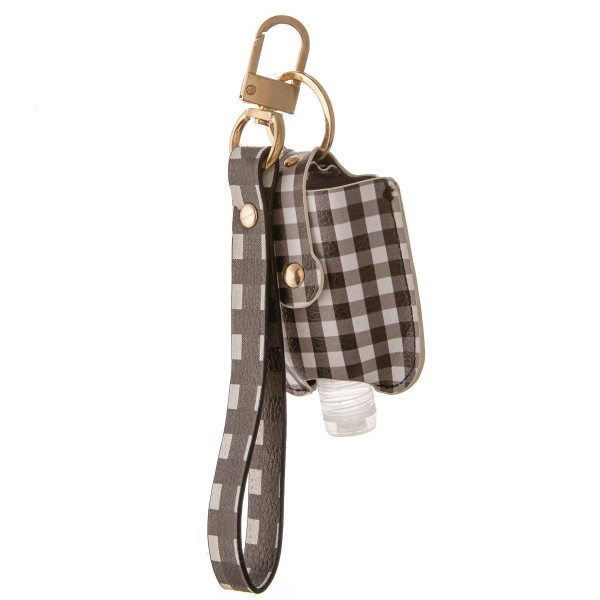 """Keep Your Self Protected While You're Out and About with This Faux Leather Buffalo Check Hand Sanitizer Holder Wristlet.  - Clip to your purse, bag, or diaper bag - Key ring to hold your keys - Detachable Wristlet 7"""" - Fits up to 1fl.oz Sanitizer Bottle - Approximately 3"""" T x 2.5"""" W  ***Hand Sanitizer NOT INCLUDED. (Comes with empty Bottle)"""