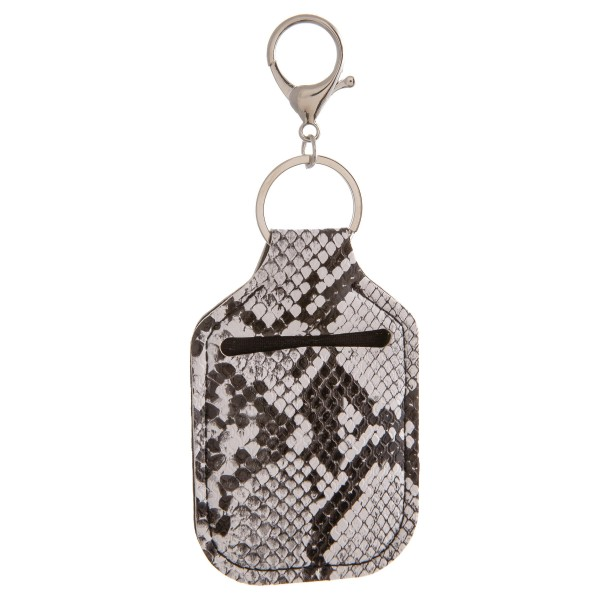 "PU Neoprene Snakeskin Hand Sanitizer Holder/Keychain Holder.  - Can Attach to Keys / Purses / Bags / Backpacks Etc. - Hand Sanitizer Not Included** - Holds 1fl. oz Bottle  - Outside Material: PU - Inside Material: Neoprene - Approximately 4"" T x 2.5"" W"