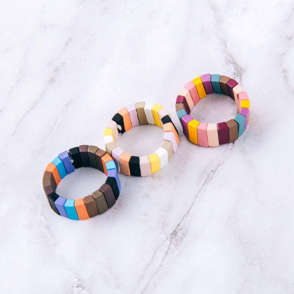 Color block stretch ring.   - One size fits most - Fits up to a size 8 ring