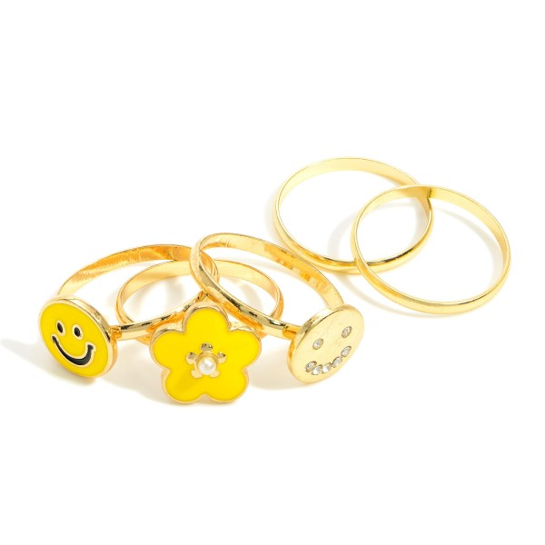 Set of 5 Gold Rings Featuring Smiley Face and Flower Accents.  - One Size Fits Most