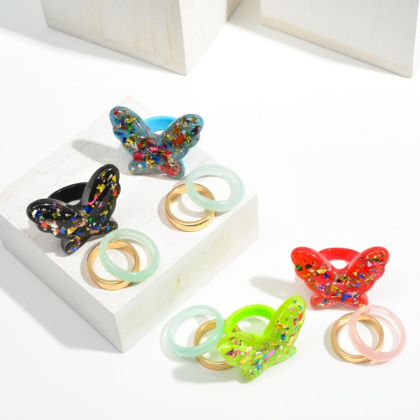 Set of Three Resin Rings Featuring Glitter Butterfly and Gold Tone Metal Ring  - Size 7