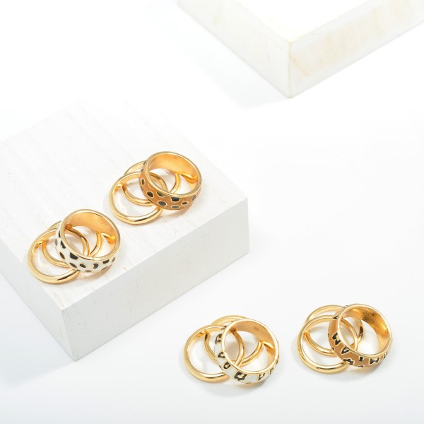 Set of Three Stackable Gold Toned Rings Featuring Animal Print Enamel  - Size 7
