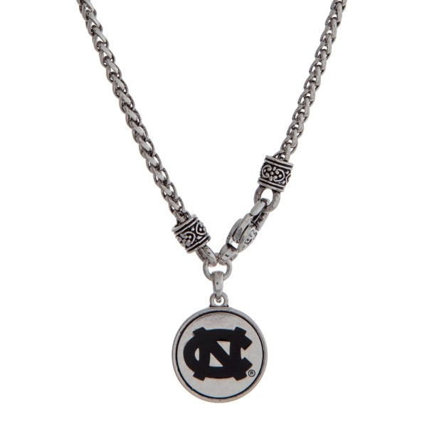 """Officially licensed University of North Carolina silver tone necklace with a front lobster claps and a logo charm. Approximately 18"""" in length."""