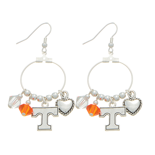 "Silver tone officially licensed fishhook earrings featuring Tennessee Volunteers charm. Approximately 1"" in length."