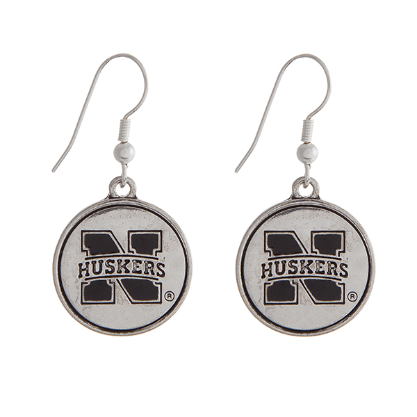"""Officially licensed University of Nebraska silver tone fishhook earrings with a circle logo. Approximately 2"""" in length."""