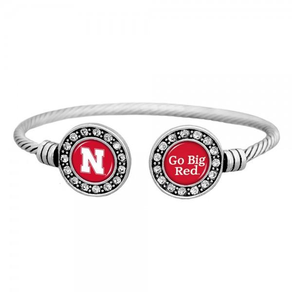 Officially licensed University of Nebraska silver tone open cuff bracelet.