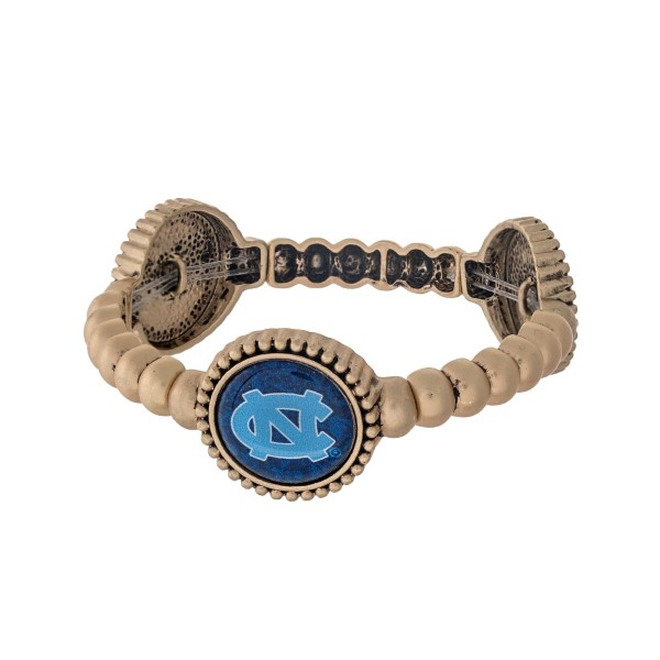 Officially licensed gold tone University of North Carolina stretch bracelet with three stations. Our own exclusive design.