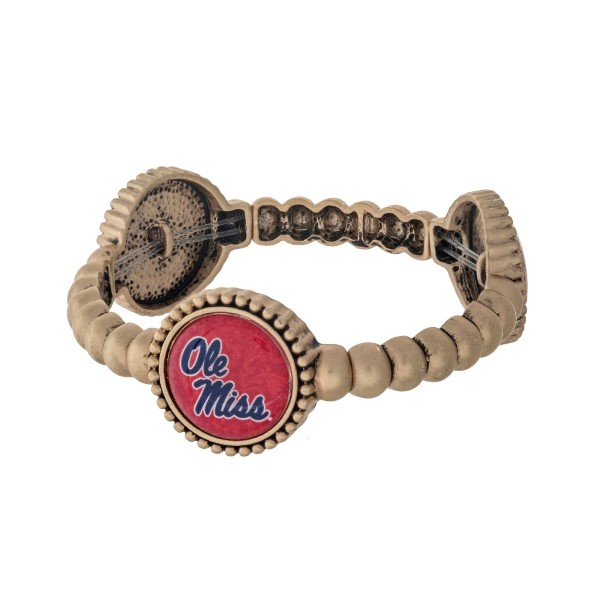 Officially licensed gold tone Ole Miss stretch bracelet with three stations. Our own exclusive design.