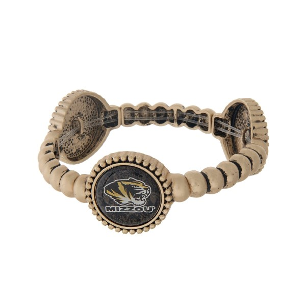 Officially licensed gold tone University of Missouri stretch bracelet with three stations. Our exclusive design.