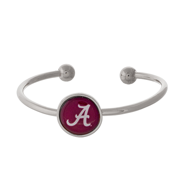 Officially licensed, silver tone cuff bracelet with the University of Alabama logo.