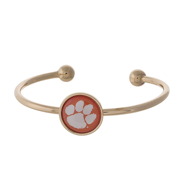 Officially licensed, gold tone cuff bracelet with the Clemson University logo.