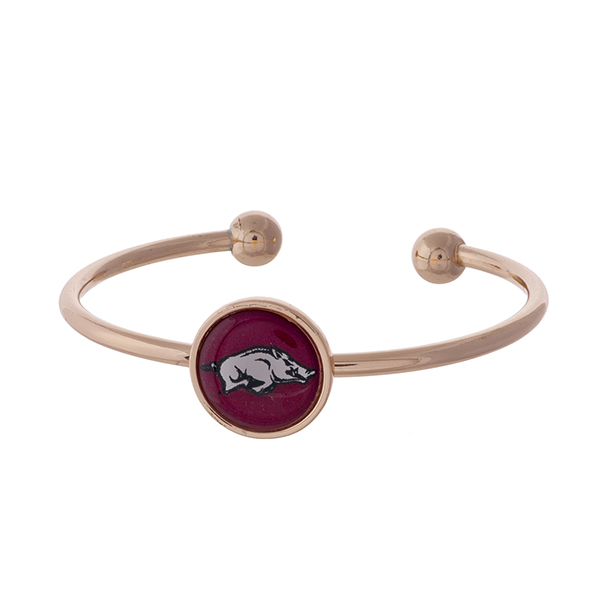 Officially licensed, rose gold tone cuff bracelet with the University of Arkansas logo.