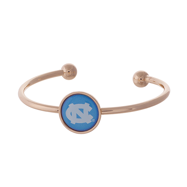 Officially licensed, rose gold tone cuff bracelet with the University of North Carolina logo.