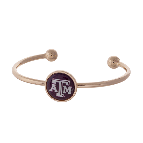 Officially licensed, rose gold tone cuff bracelet with the Texas A&M University logo.