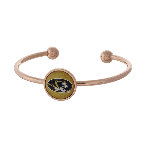 Officially licensed, rose gold tone cuff bracelet with the University of Missouri logo.