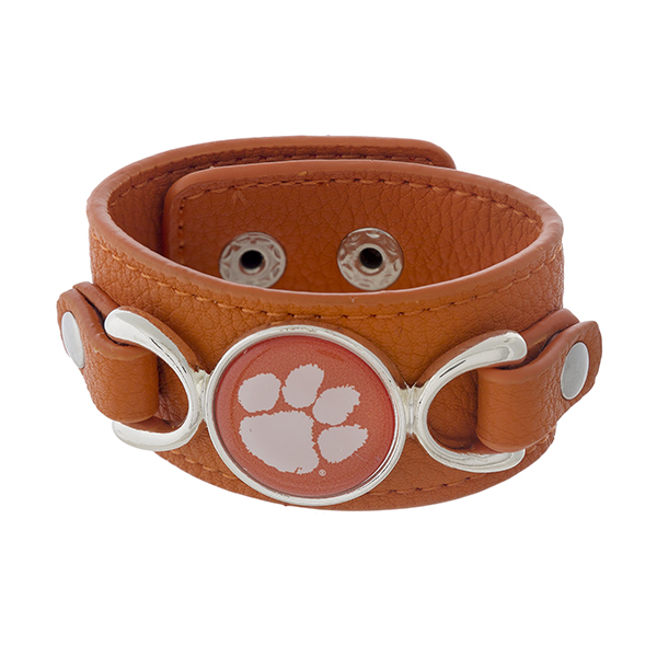 "Officially licensed, faux leather bracelet with the Clemson University logo. Approximately 1"" in width."