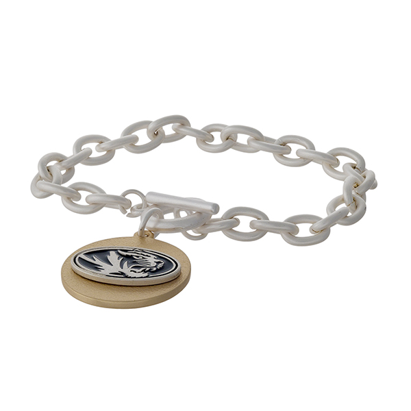 Officially licensed, two tone toggle bracelet with the University of Missouri logo charm.