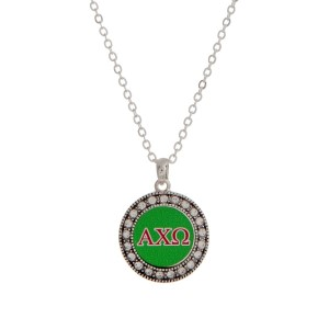 "Silver tone officially licensed Alpha Chi Omega pendant necklace with rhinestone accents. Approximately 17"" in length."