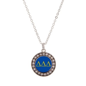 "Silver tone officially licensed Delta Delta Delta pendant necklace with rhinestone accents. Approximately 17"" in length."