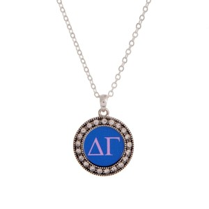 "Silver tone officially licensed Delta Gamma pendant necklace with rhinestone accents. Approximately 17"" in length."