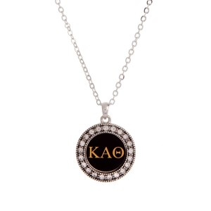 "Silver tone officially licensed Kappa Alpha Theta pendant necklace with rhinestone accents. Approximately 17"" in length."