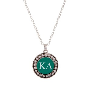 "Silver tone officially licensed Kappa Delta pendant necklace with rhinestone accents. Approximately 17"" in length."