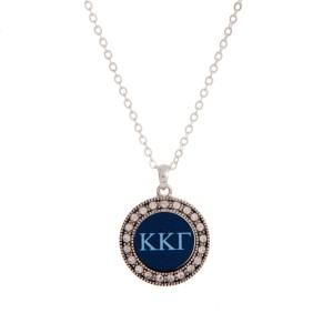 "Silver tone officially licensed Kappa Kappa Gamma pendant necklace with rhinestone accents. Approximately 17"" in length."