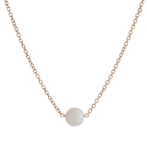 """Dainty gold tone necklace with a single faux ivory pearl. Approximately 16"""" in length."""