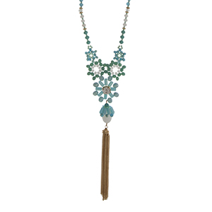 """Gold tone half beaded necklace with turquoise and white beads displaying flowers with a rhinestone and hanging chain tassel. Approximately 30"""" in length."""