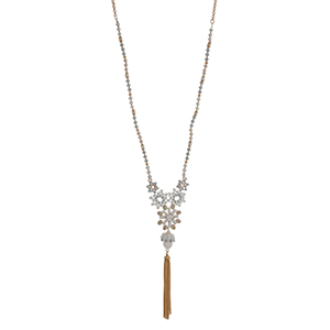 """Gold tone half beaded necklace with white and gray beads displaying flowers with a rhinestone and hanging chain tassel. Approximately 30"""" in length."""