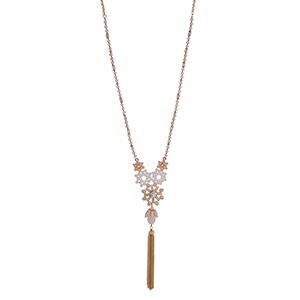 """Gold tone half beaded necklace with pink and peach beads displaying flowers with a rhinestone and hanging chain tassel. Approximately 30"""" in length."""