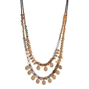 """Peach, green, and gray, beaded layering necklace displaying beige chipstone, gold tone  leaves, and gold tone disk. Approximately 18"""" in length."""