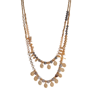 """Gray, ivory, and gold tone beaded layering necklace displaying beige chipstone, gold tone leaves, and gold tone disk. Approximately 18"""" in length."""