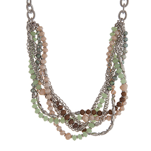 "Silver tone chain link necklace displaying rows of mint, ivory, and brown beads. Approximately 16"" in length."