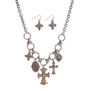 "Burnished silver tone necklace set with two tone cross charms. Approximately 18"" in length."